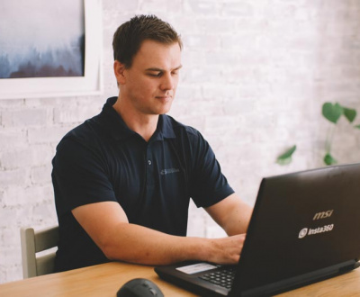 Web Design Company - Man working on Laptop in office